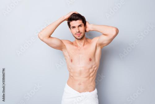Vászonkép Portrait of masculine brutal macho man have hairstylist hygiene procedure touch