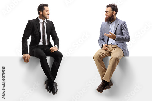 Carta da parati Man in a suit and a bearded man sitting on a blank panel and talking