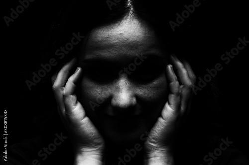 Carta da parati High contrast image of disturbed emotionally overcome mentally unbalanced woman