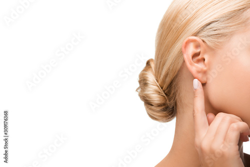 Carta da parati cropped view of blonde girl pointing with finger at ear isolated on white