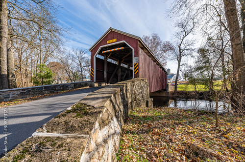 Fototapeta Zook's Mill Covered Bridge Spanning Cocalico Creek in Lancaster County, Pennsylv
