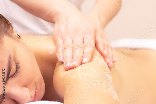 Fototapeta massage and skin cleansing with a scrub