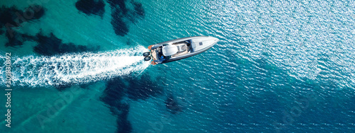 Fotografering Aerial drone ultra wide top down photo of luxury rigid inflatable speed boat cru