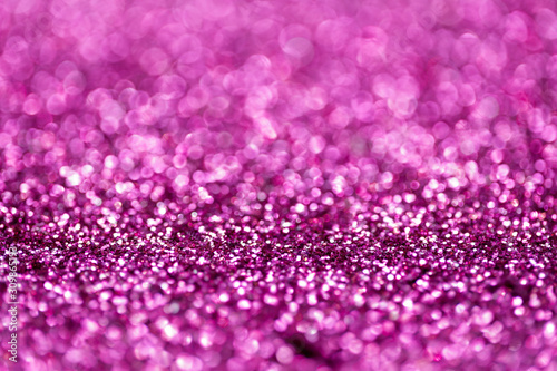 Pink and purple glitter, Defocused abstract holidays lights With Sparkle for background.