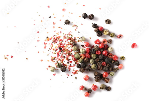 Stampa su Tela Colorful mixed pepper grains and flakes, isolated on white background, top view