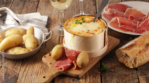 Canvastavla fondue cheese, french gastronomy with salami and potato