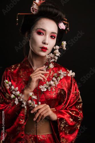 Valokuva Image of brunette geisha woman in japanese kimono with sakura tree