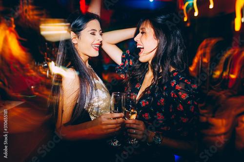 Obraz na płótnie Two girls having fun at the club on New Year's party