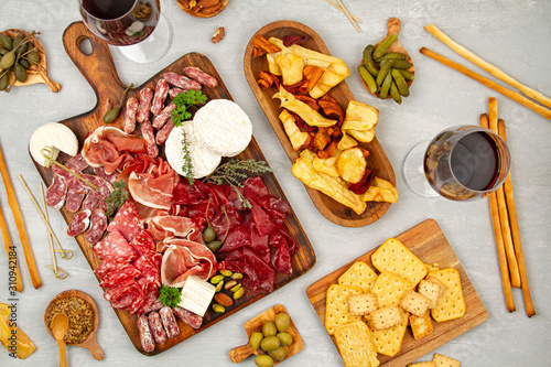 Canvas Print Appetizers table with differents antipasti, charcuterie, snacks and wine
