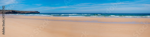 wide sandy beach Bordeira, west algarve portugal. without people Fototapete