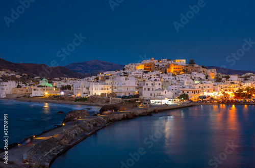 фотография Chora of Naxos island as seen from the famous landmark the Portara with the natural stone walkway towards the village, Cyclades, Greece