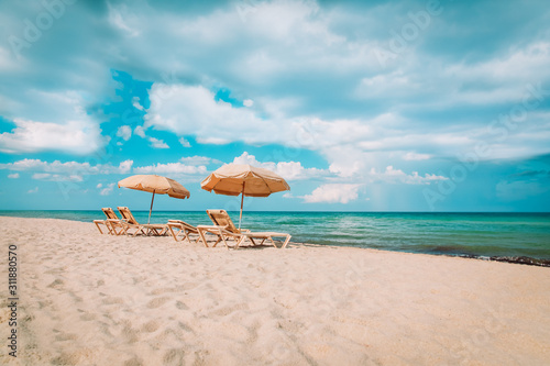 Fototapeta Beach chairs on tropical vacation, travel to sea concept