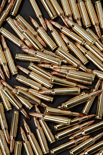 Fototapeta Cartridges for weapons on a dark background