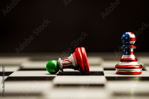 USA flag and Iran flag print screen on chess.It is symbol of United state of America and Iran have conflict in nuclear weapons and Strait of Hormuz.