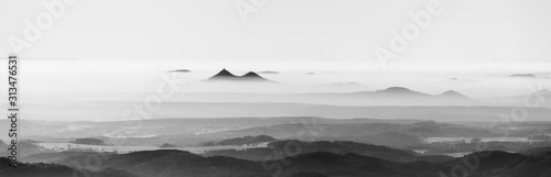 Bezdez twin mountains rising from the mist. Weather temperature inversion, Cz...