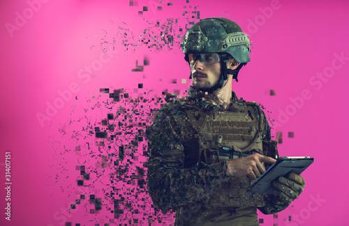 Canvas Print soldier using tablet computer closeup