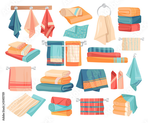 Fotografia Large set of colored towel icons hanging on pegs, folded in assorted stacks and