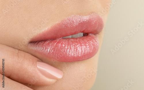 Carta da parati Woman with beautiful full lips on beige background, closeup