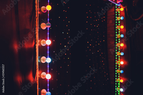 Carta da parati Light Bulbs On Stage Theatrical scene with colored glitter neon bulbs for presentation or concert performance