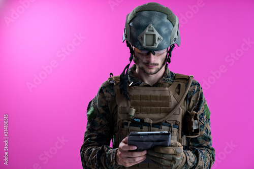 Photo soldier using tablet computer closeup