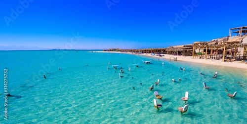 Fototapeta Orange Bay Beach with crystal clear azure water and white beach - paradise coastline of Giftun island, Mahmya, Hurghada, Red Sea, Egypt