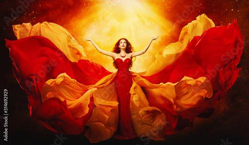 Obraz na plátně Woman in Flying Dress Raised Arms to Mystery Light, Fantasy Goddess in Red Flutt