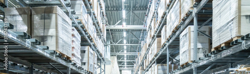 Fotografiet Rows of shelves with boxes in modern warehouse