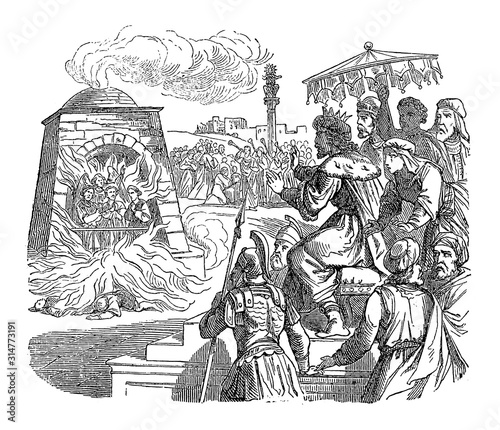 Fotografía Vintage drawing or engraving of biblical story of three Jews set in fire in roaring furnace by king Nebuchadnezzar of Babylon, but rescued by angel