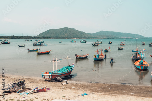 Fishing boats in the sea bay in Prachuap Khiri Khan district, Thailand Fototapet