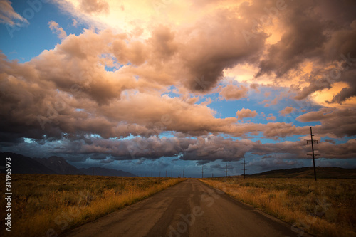 Wallpaper Mural Dramatic clouds over road in Grand Teton National Park.