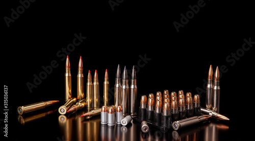 Obraz na płótnie Bullet isolated on black background with reflexion