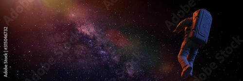 Fotografia astronaut flying towards the beautiful Milky Way galaxy