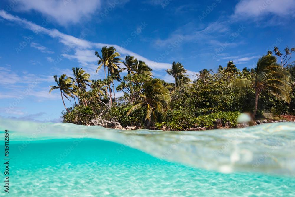 Tropical island beach beyond ocean surface, Vava'u, Tonga, Pacific Ocean