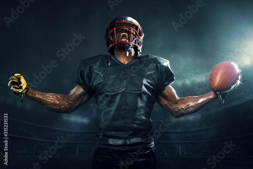 Canvas Print Muscular football player cheering