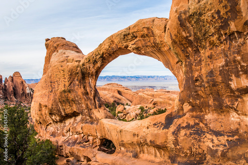 Fototapeta Arches national park, USA, Utah, Moab - MARCH 2018: The unique rock formation ,arch, is typical for this national park