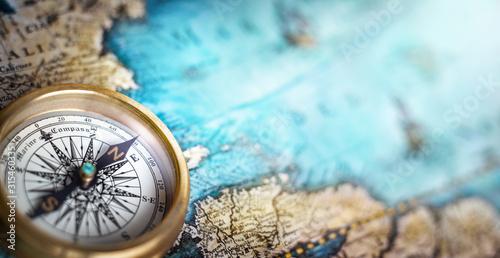 Magnetic compass on world map Fototapeta