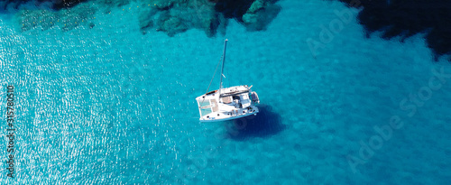 Canvas Aerial drone ultra wide photo of sailing yacht docked in paradise turquoise sea