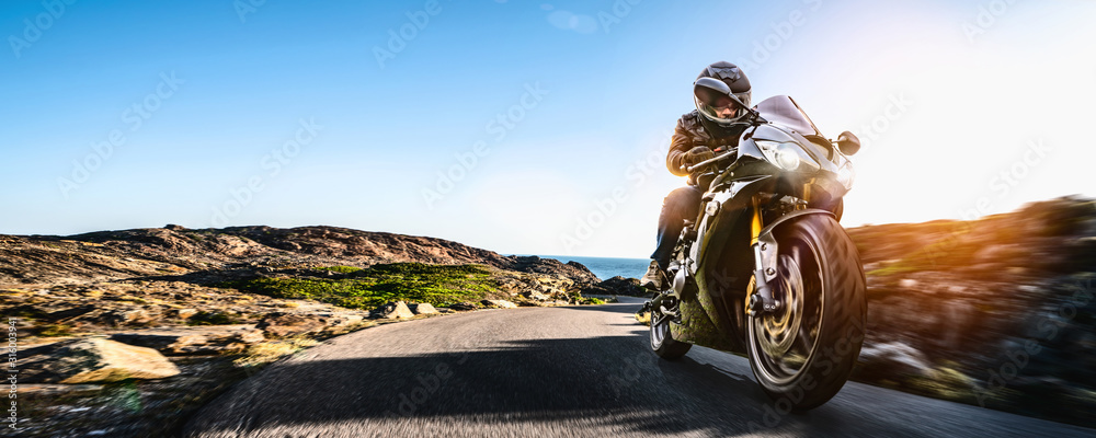 motorbike on the coastal road riding. having fun driving the empty highway on a motorcycle tour journey <span>plik: #316003941 | autor: AA+W</span>