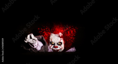 Stampa su Tela the evil clown killer peeps out of cover