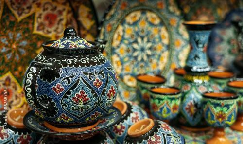 Fényképezés Ethnic Uzbek ceramic tableware with traditional uzbekistan ornament