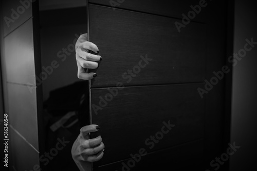 Fotografia Horror shoot, hand of woman out from the closet in white tone