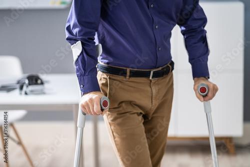 Fotografia Handicapped Man Walking With Crutches