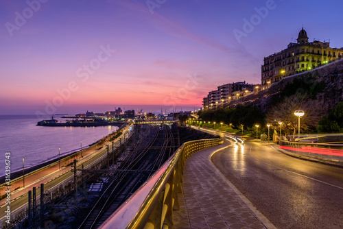 Cityscape of Tarragona. Beautiful view of Tarragona city and the Mediterranean coast at sunset, Catalonia, Spain.