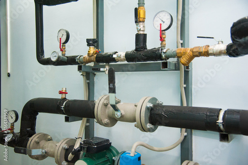 Photo Manometer, pipes and faucet valves of heating system