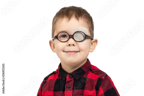 Fotografia, Obraz little funny Caucasian kid in round glasses wearing eye correcting patch because