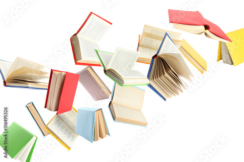 Valokuvatapetti Colorful hardcover books flying on white background