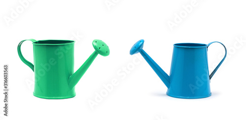 Fototapeta Blue watering can isolated on a white background.
