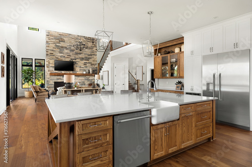 Canvas-taulu Kitchen and living room interior in new luxury home with open concept floor plan