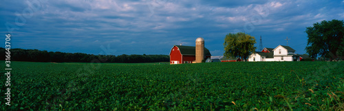 This is a farm with a silo and barn Fototapeta