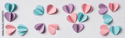 top view of love lettering made of colorful paper hearts on white background, panoramic shot